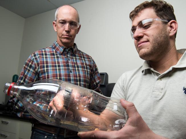 Desktop scientists plastic bottle