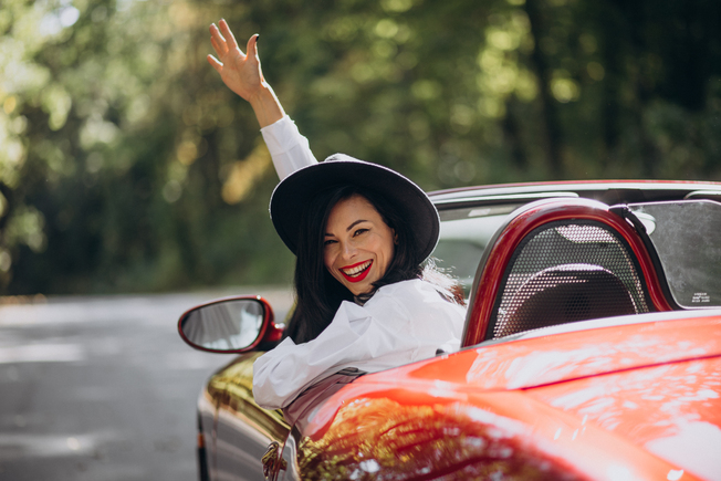 Desktop 4th woman in a red car