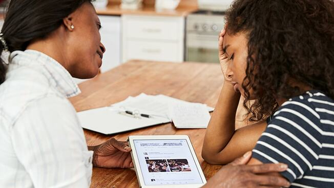 Desktop mother and daughter study stress